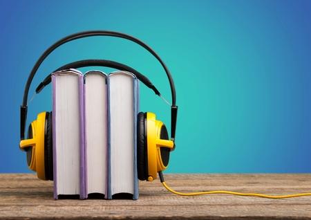 Book with Yellow headphones Фото со стока