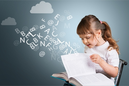 cute little girl with glasses reading a book with departing letters about Chalkboard Фото со стока - 92420142