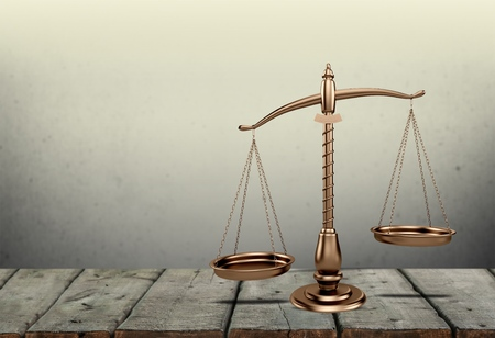 Law scales on table. Symbol of justice. Vintage sepia photo Stockfoto