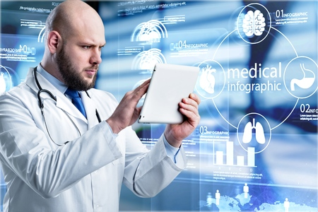 Doctor or medical students using digital tablet find information patient medical history at the hospital. Medical technology concept.