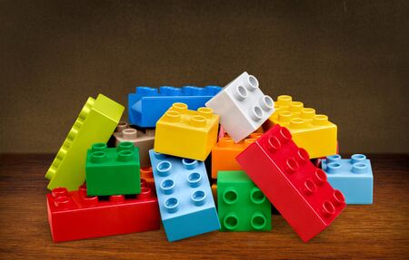Small pile of colorful childrens building bricks on white Stock Photo