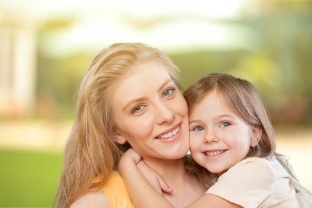 portrait of happy white mother and young daughter - isolated. Happy family people concept. Stock Photo