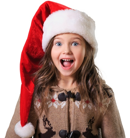 Little girl in santa hat isolated on white background