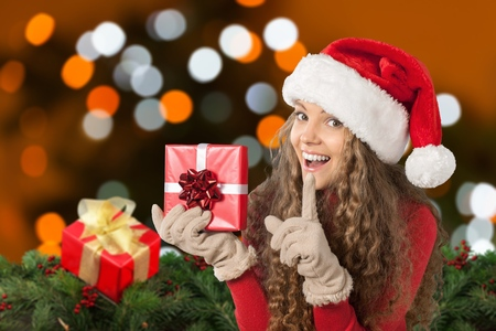 Attractive Young Woman in Sweater with Red Gift Box Stock Photo