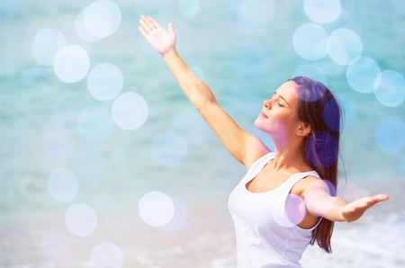Portrait of a Woman with Arms Open at the Beach Stock Photo
