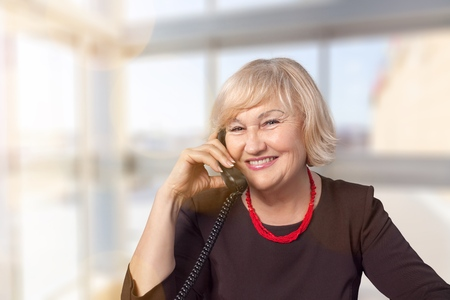 Businesswoman with phone on white