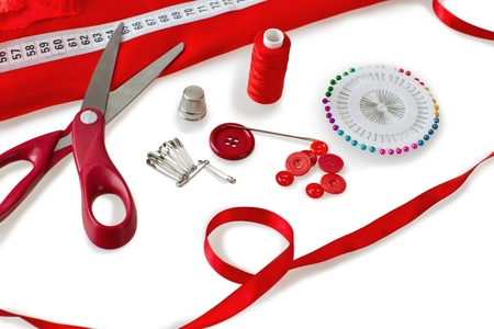 Sewing tools - scissors, buttons, sewing pins, sewing needle, safety pins, thread and fabric Foto de archivo