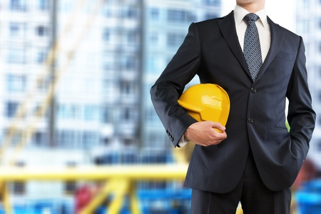 A engineer holding hard hat Stock Photo