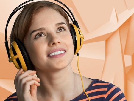 Relaxed young woman listening music