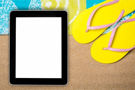 Tablet computer with blank screen on beach sand with beach items, top view. Summer background Фото со стока