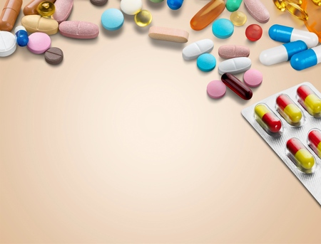 medicine background concept the medicine drugs, pills, capsule, tablets,drugs packaging on wood table  texture background.