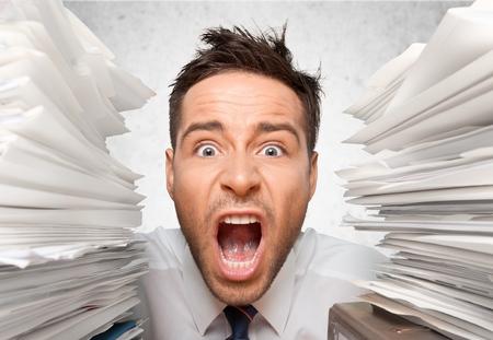 Wide-Eyed Office Worker Screams for Help between Folders
