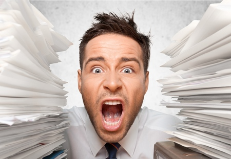 Wide-Eyed Office Worker Screams for Help between Folders