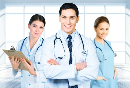 attractive male doctor in front of medical group Stok Fotoğraf
