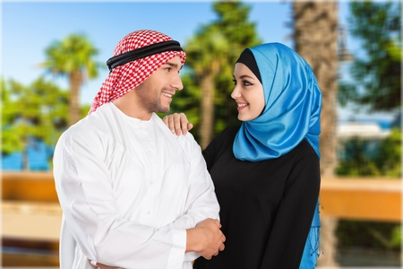 Saudi arab couple marriage looking with love isolate don a white background Stok Fotoğraf