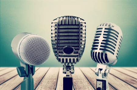 Retro old microphones for press conference or interview on table. Vintage style filtered photo Stock Photo