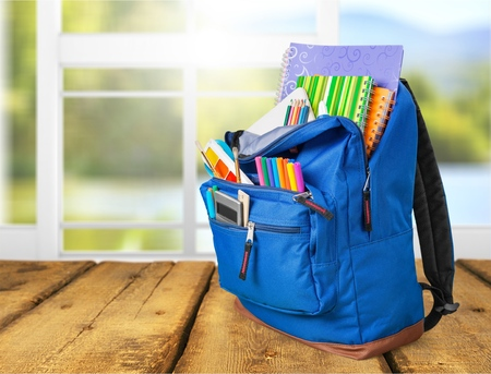 backpack with school supplies including, notebooks, pens, pencils, rulers and glue