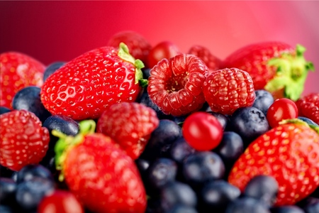 ripe of  berries on wooden table in garden  - blackberry, raspberry , red currant and blueberry 写真素材