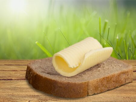 Butter curl on a slice of white bread Stock Photo