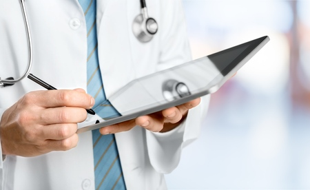 doctor holding touchscreen tablet