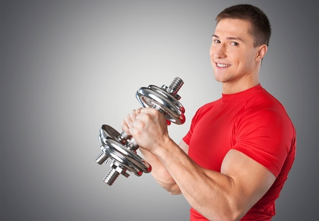 Happy Senior with Dumbbells Stock Photo