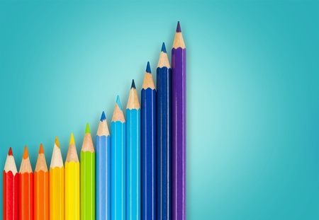 color pencils as the graph of growth and achievement isolated on a white background
