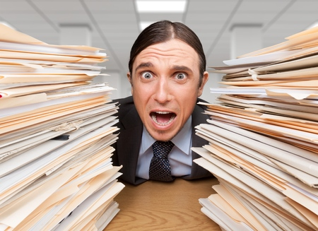 Wide-Eyed Office Worker Screams for Help btwn Folders