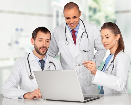 Doctors working on a laptop Stock Photo