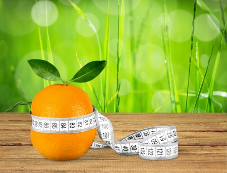 Orange Fruit with measurement isolated on white