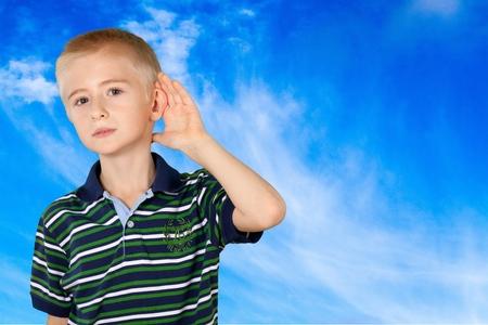 Boy cupping ear