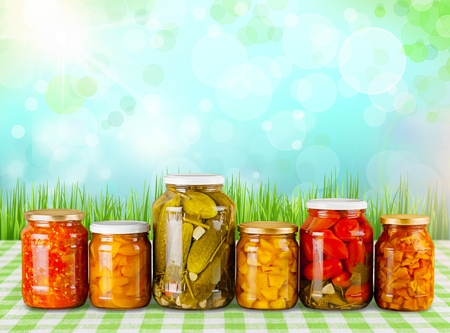 Home Canning Jars of Summer Harvest Vegetable on White Backgroun