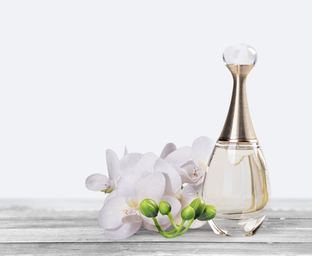 perfume bottle and floral decoration