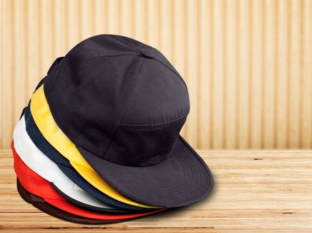 baseball caps stacked