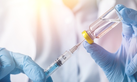 injecting injection vaccine medicine flu Stock Photo
