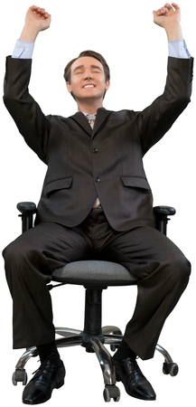 Happy businessman on chair isolated on white background Stock Photo
