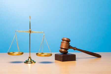 Law scales, judge gavel on table. Symbol of justice.