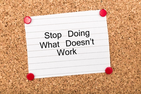 The phrase Stop Doing What Doesnt Work on a paper note pinned to a cork notice board. In both business and our own lives we have to look for efficiency and best practice to move forward. Standard-Bild