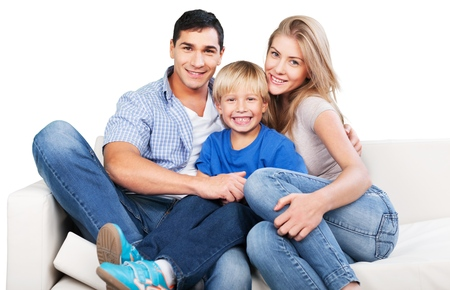 Smiling family sitting at sofa isolated on white background