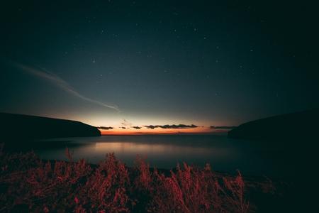 good red sunset over darken sea Standard-Bild