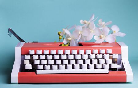 Typewriter and flowers