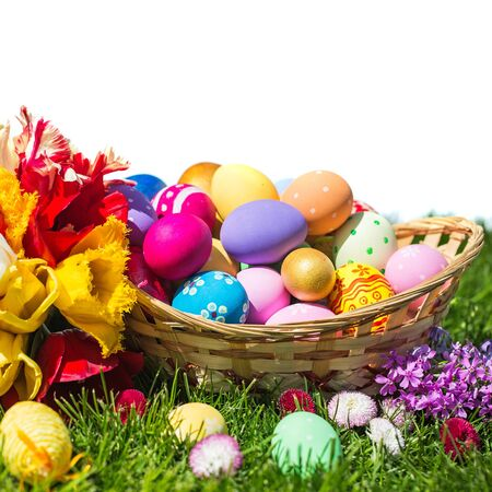 Picture of colorful easter eggs laying on the grass with a bright Cross Standard-Bild
