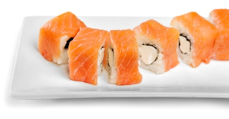 Tasty Sushi rolls on plate on  background