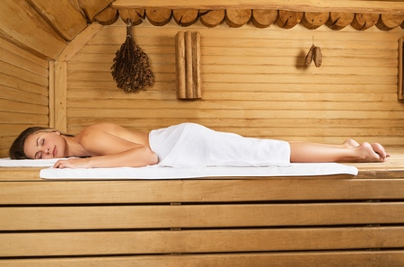 Woman Relaxing in the Sauna