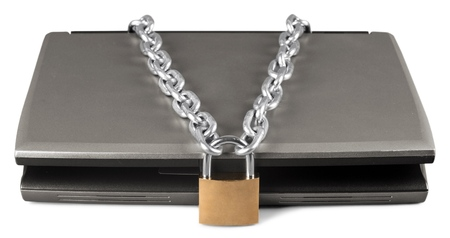 Padlock and Chain on a Laptop