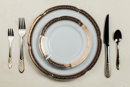 Table Setting with Plate, Forks, Knife and Spoon Stock Photo