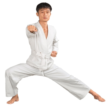 Asian Karate fighter in White Kimono on white background Stock Photo