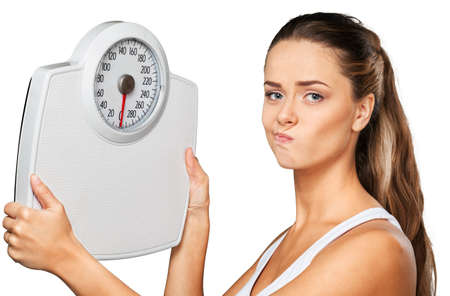 Portrait of an Unhappy Woman Holding a Weight Scale Stock Photo