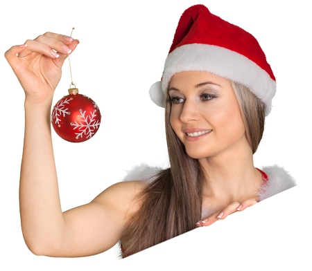 Beautiful woman in Santa hat holding Christmas bauble Stock Photo