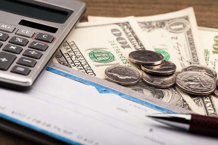 Checkbook, Pen, Calculator and Money - Close Up Stock Photo - 93620307