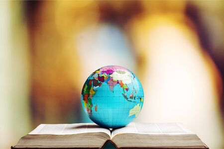 Open book and globe world 写真素材